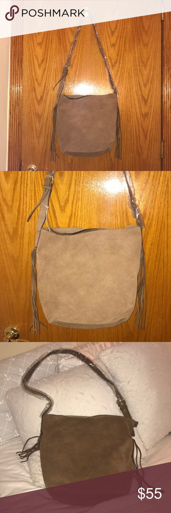 Gap brand new suede bag Brand new with tag Gap Cognac Suede bag!! This bag is a cross body with adjustable strap! Zipper closure . Middle to large . Bag has a zipper on the inside ! Fringes on the side ! Gorgeous gorgeous bag ! Great addition to any wardrobe! GAP Bags Crossbody Bags