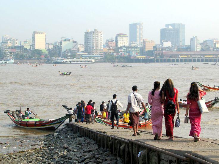Commuters at Dalah use long tail boats to cross the Yangon (Hlaing) River to Yangon, Myanmar (Burma).
