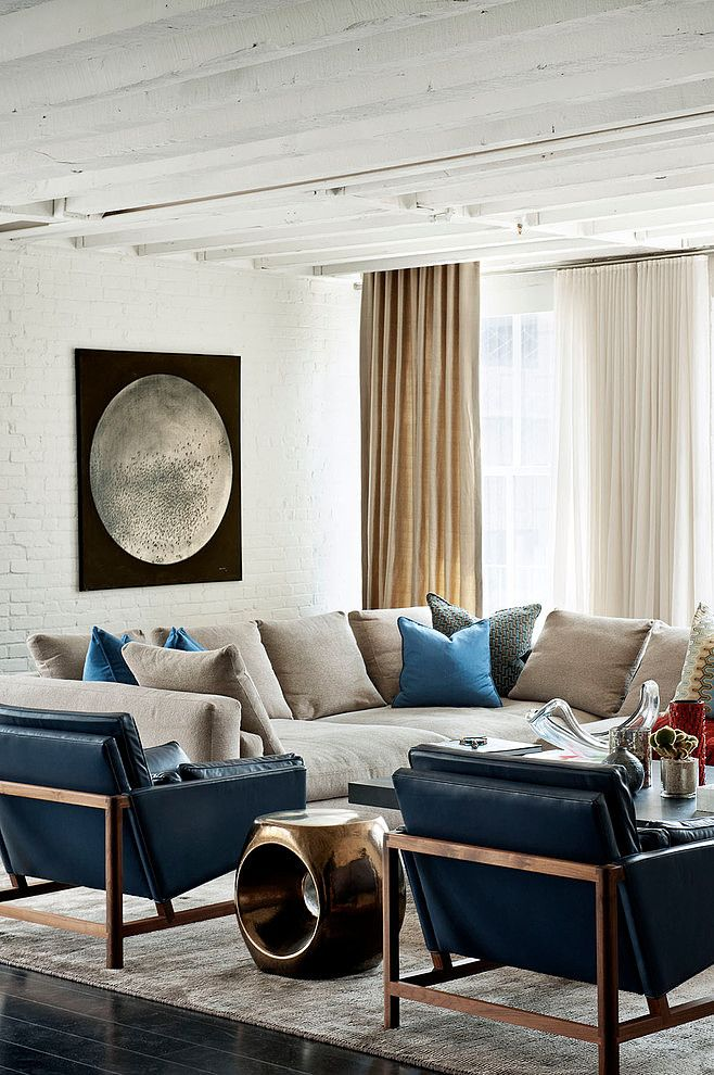 Stunning living space with dark floors and accents in gold and blue. Laight Street Loft by David Howell Design