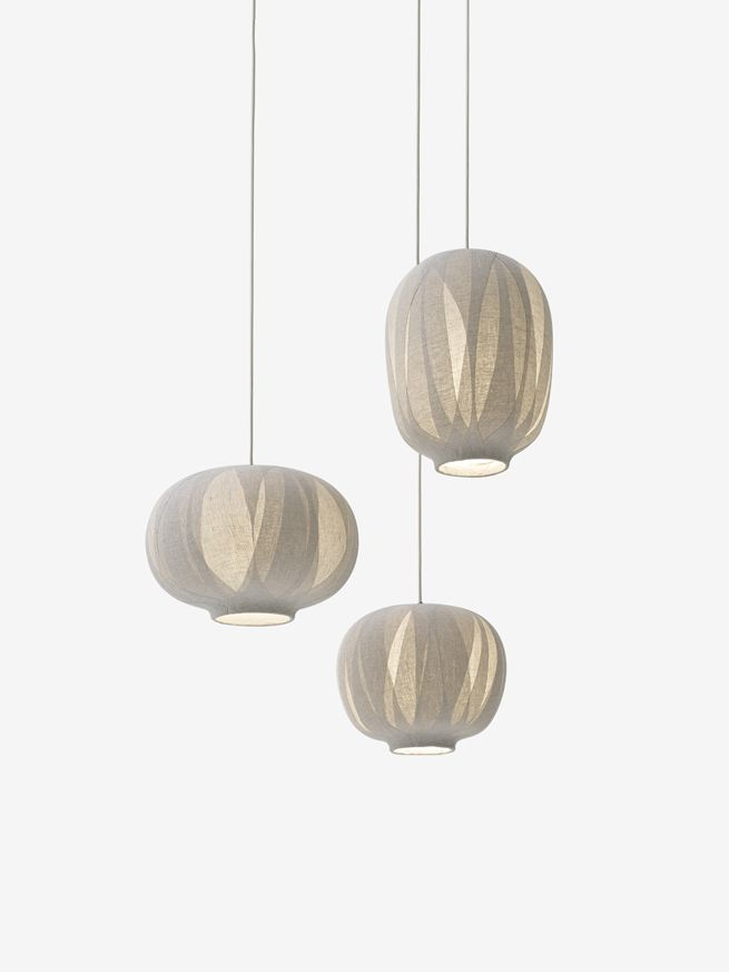 nuno for Vibia We layered and adhered cloth ('nuno' in Japanese) onto the surface of a resin-formed lampshade to create a lighting fixture that blends into the interior like a decorative object when extinguished, and creates complex and beautiful shadows when lit.