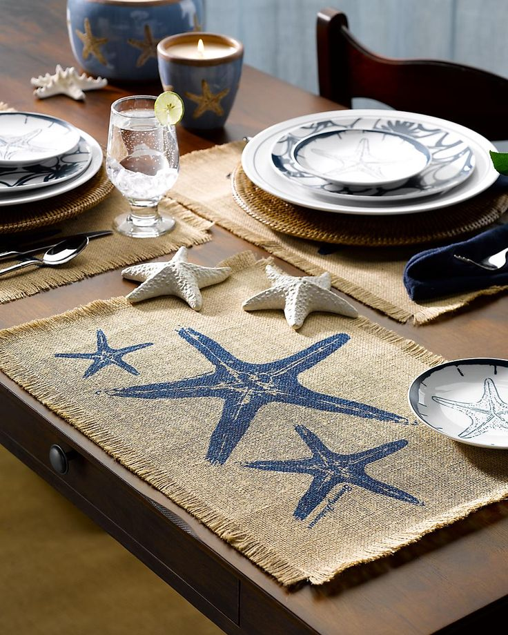 Throwing a seaside dinner party? Invest in some small decor pieces for the table, like sea shells, starfish or marine themed placemats.