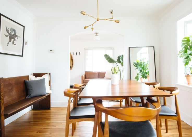 The paint color all over the house is Behr's Ultra Pure White. The dining table is from  West Elm.