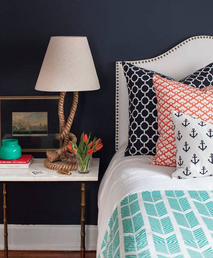 navy blue nautical themed boys bedroom ideas with anchor pattern on pillows and nautical ropes on