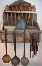 wooden spoon & kitchen utensil's with wall holder.