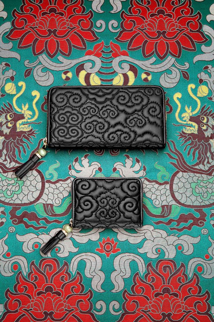 Head in the Clouds This quilted shoulder bag  by Shanghai Tang is made from extra-soft lamb leather, and uses the auspicious cloud motif and lucky adventurine as a twist lock.