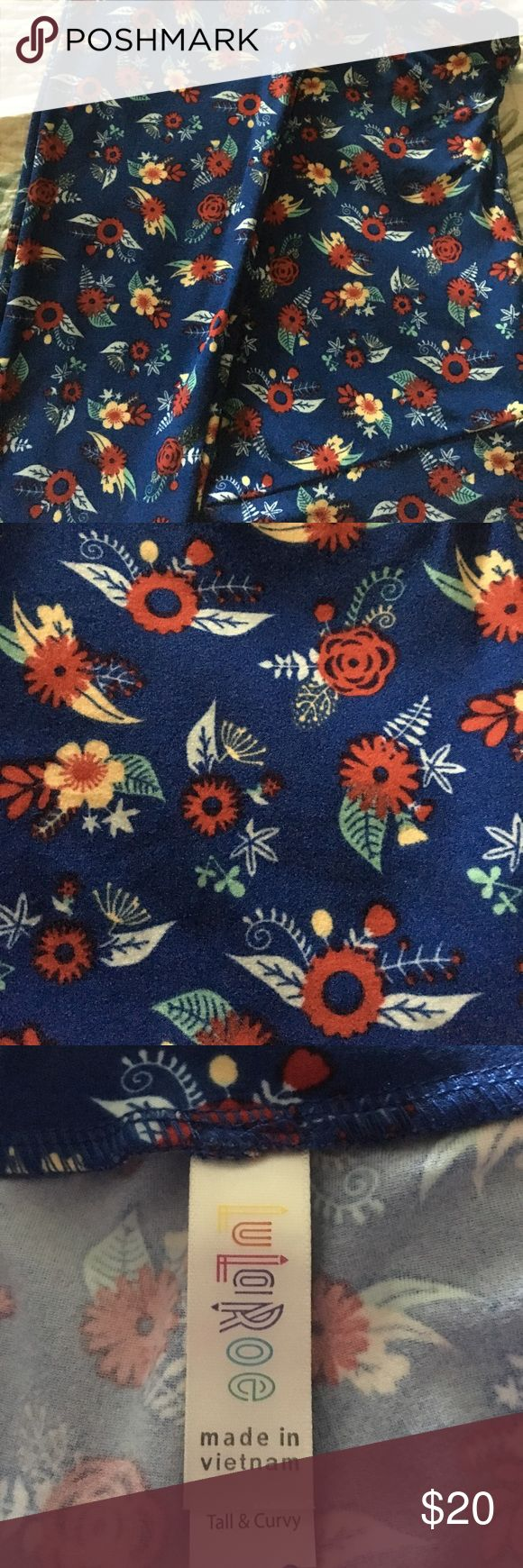 Adorable Flowered LulaRoe TC Leggings Brand new cute as a button Lularoe TC leggings.  Royal Blue background with tiny yellow and red flowers with delicate leaves. Perfect addition to your wardrobe! LuLaRoe Pants Leggings