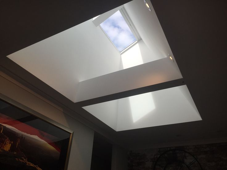 Two VELUX Fixed Skylights installed side by side over the living area of this Karrinyup home.  The skylights were centred over the structural LVL beam to create a great feature and lightwell.  Shaft gyprock lined and LVL beam encased in gyprock.