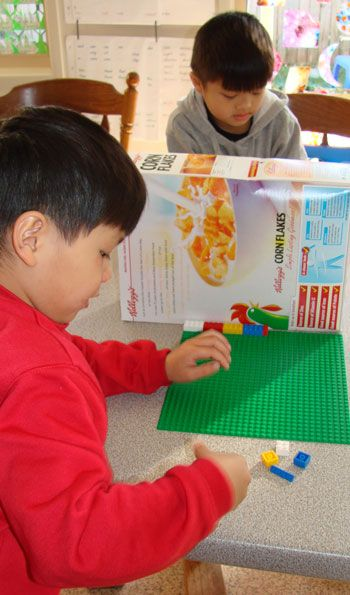 The Objective of the Lego Listening Game   … is for one player to arrange his/her blocks in exactly the same design/pattern as the other player.   The catch is that players cannot see each others' blocks/board but must rely only on verbal instructions.  This is a fabulous game for developing both spoken language and vocabulary as well as listening skills!
