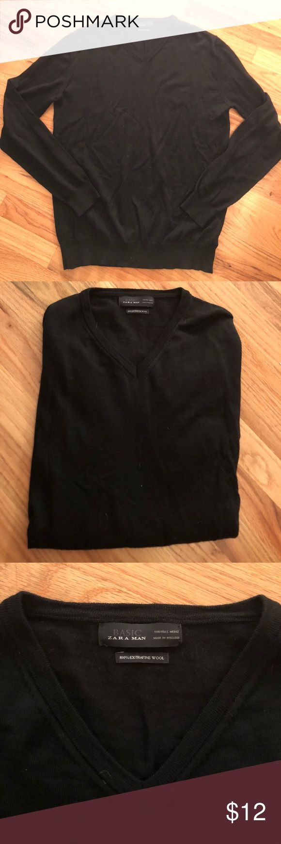 ZARA man, Basic black Wool sweater, LG Preloved.  Maybe worn twice.  Dry cleaned only.  Solid black ZARA Basic Man v neck sweater.  100% extra fine wool. Small pull at bottom, see picture, not noticeable when on. Zara Sweaters V-Neck