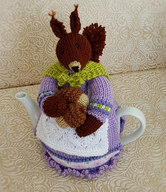 Beatrix Nutcracker Squirrel Tea Cosy knitting pattern by Marcelline Simonotti, also found at www.tbeecosy.com http://www.tbeecosy.com/product/beatrix-nutcracker-squirrel-tea-cosy