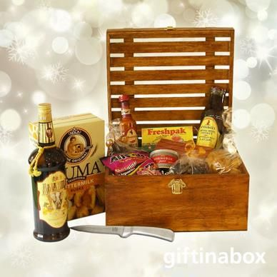 Our good old South African favourites for the true spirited patriot.Try out this gourmet gift hamper. All treats are lovingly presented in an exquisite wooden crate with hinged lid and filled with wood wool.  100g Dried wors 375ml Bottle of Amarula cream liquor 80g Kudu wors 80g Beef biltong Springbok pate tin Ouma rusks Koeksisters Rooibos tea Chutney Hot peri peri sauce Guava fruit rolls Liquorice all sorts Stainless steel biltong knife 4 x Christmas chocolate mini slabs