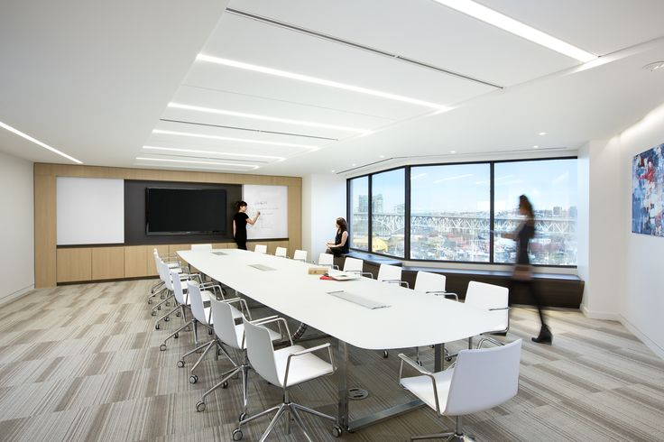 SSDG Interiors Inc. | workplace executive office: Financial Institution. Bright and modern interior design of an office in Vancouver. Conference room / boardroom with media wall.