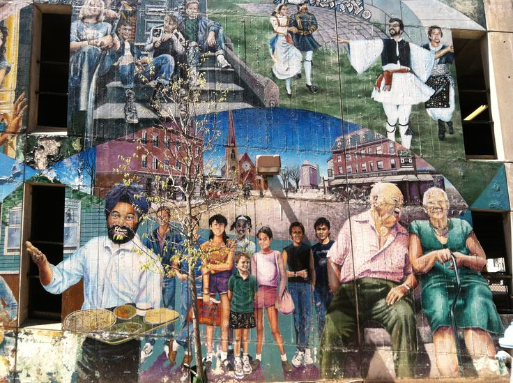 Part of a large mural celebrating the diversity of Central Square.  This is on the side of the Central Square branch of the Cambridge library, on Pearl Street.
