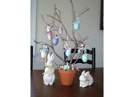 This Easter tree makes a great center piece on your table and is easy to make.  I took a small pot and filled it with styrofoam and covered it with moss.  I then found a small branch and stuck it in the middle.  Next I took some blown dyed eggs and tied ribbons to them in order to hang them from the tree. I also found some little decorative eggs at a local craft store to place in the moss.  You may also want to spray paint your tree a color such a white. A great project to do with the kids!