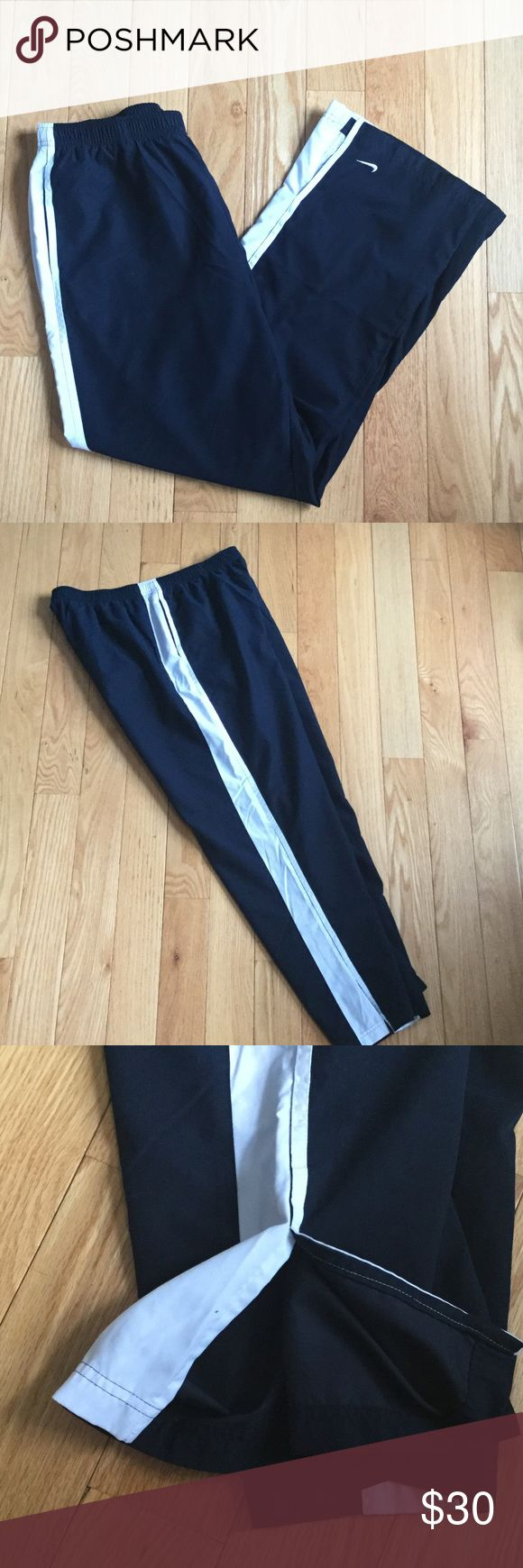 Men's navy and white jogger pants In perfect condition. Nike workout pants. Navy and white, this picture just looks like black. 100% polyester. Nike Pants Track Pants & Joggers
