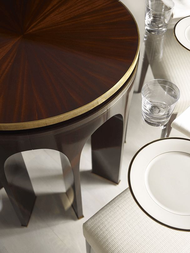 The Arcade Center Table by Thomas Pheasant for Baker Furniture is finished with an elegant, ribbed brass banded wood top.
