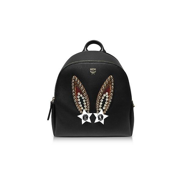 MCM Handbags Mini Black Leather Polke Bunny Studs Backpack (2,285 CAD) ❤ liked on Polyvore featuring bags, backpacks, black, handbags, mcm backpack, leather backpack, real leather backpack, studded backpack and leather zipper backpack