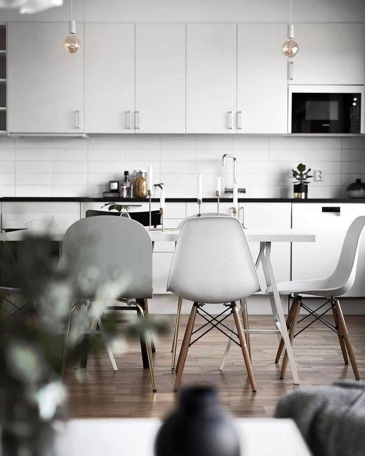 Lovely and white kitchen design.