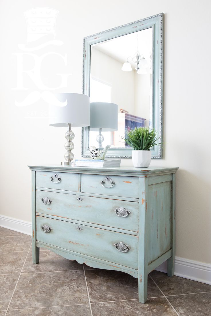 Chest / Dresser Painted in Annie Sloan Duck Egg, Clear Wax, Dark Wax Glaze.  Rub and Buff Pewter wax over hardware and along mirror edges.