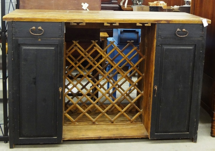 Looking for that final piece to complete your entertainment room we have it a Southwest Style Bar with wine and glass storage.  Price: $450.00 http://www.theguildshop.org/southwestern-style-bar