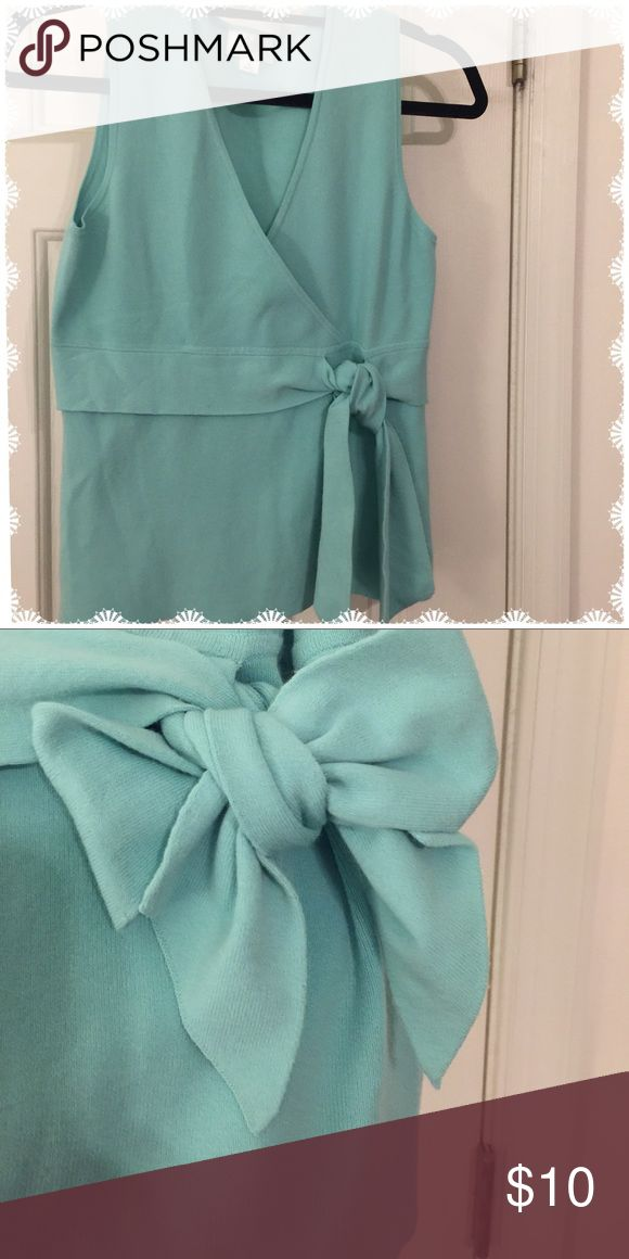 Sassy Mint Green Top With Attached Sash Sassy little sleeveless mint green top  Sash that is attached to it and can be knotted ( as shown in 1st picture) or tied in a bow. LOFT Tops Tank Tops