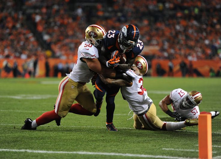 Ronnie Hillman (23) of the Denver Broncos is stopped shor tof the first down in the first quarter. The Denver Broncos played the San Francisco 49ers at Sports Authority Field at Mile High in Denver on October 19, 2014. (Photo by Tim Rasmussen/The Denver Post)-- #ProFootballDenverBroncos