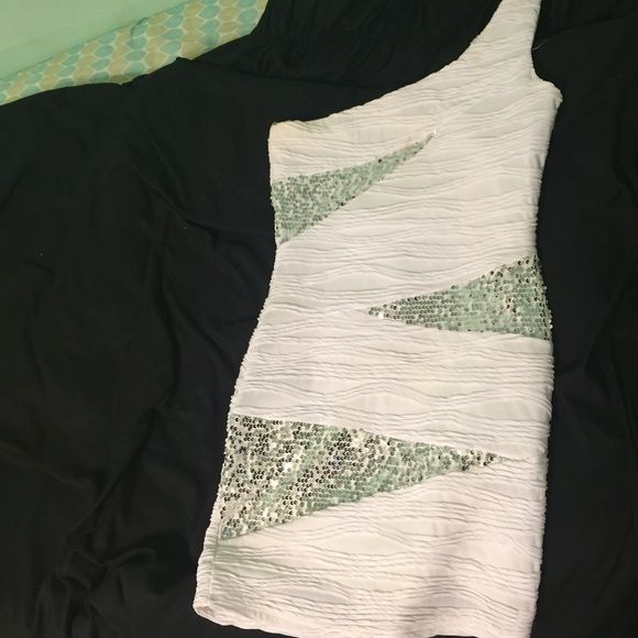 Winter formal dress! Sequins & form fitting. It's a pretty short dress and the back is plain. Ruched all over. Only worn once! No holes or stains, perfect condition! Deb Dresses