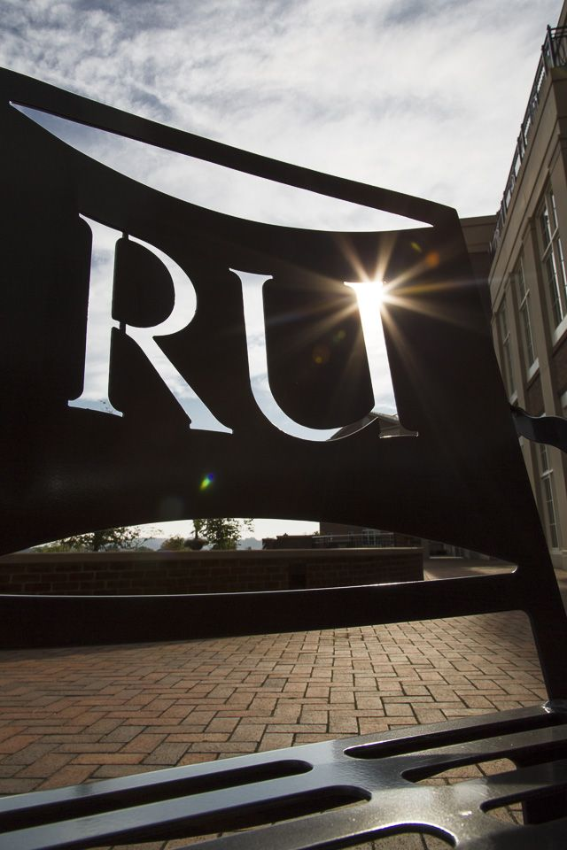 The morning light shines through the #RU logo on a campus bench. Share your scenic photos of campus by using #RadfordUniversity!