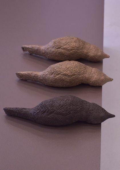Black stoneware clay hand built and hand carved bird, bronzes cast from original piece, 22cmx7cmx7cm each