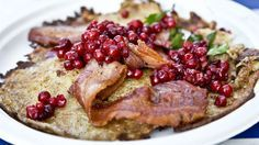 Raggmunk is the name for a Swedish potato pancake. The pancakes are fried in butter and served with fried pork and – would you believe it – lingonberries.