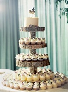 A wedding cupcake stand made from slices of tree stumps!