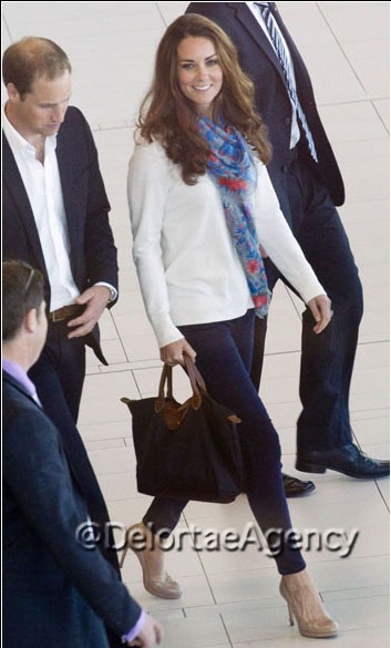 Kate Middleton (Duchess of Cambridge) at Brisbane airport on Septermber 19 2012, toting large black Longchamp Le Pliage®      *courtesy of Delortae Agency luxury authentic handbag SPA, visit us on Facebook; www.facebook.com/DelortaeAgency