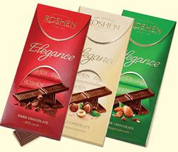 A set of three delicious Roshen Elegance chocolate bars: extra dark, extra dark almonds, and milk chocolate with hazelnuts. Each decorative box contains individually wrapped mini chocolate bars.
