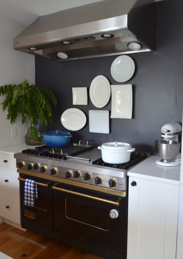 while waiting for the tile backsplash, she painted the wall black.: Stove, At Home, Plates Arrangement, White Plates, Farms, Cupboards, The Farm, Homes, White Wall