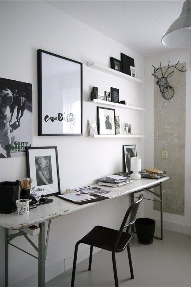 Minimalist modern black and white home office. Love that dear head wall decor. #rassphome #HomeOffice