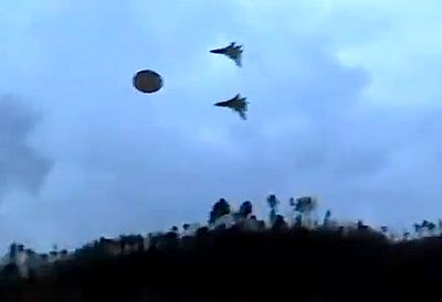 Two Military Jets Escort UFO To Secret Base, Alien Tech In Military Hands?    Here is an amazing catch by someone hiking in the hill and happens to have their video cam on. Most of us have done that at one time or another. But then suddenly two jets chasing a UFO shoot across the sky and over the hills.