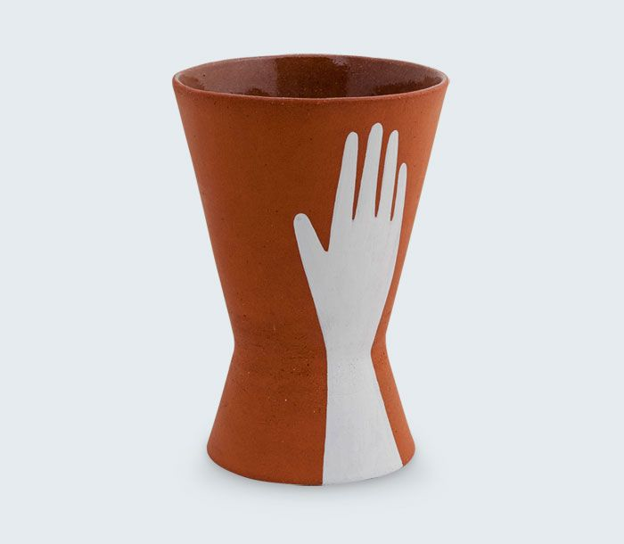 Hand Print Atomic Planter by Brisbane based ceramic artist Sharon Muir. Hand-painted red clay dish with a matte exterior and clear interior glaze. Signed by the artist.