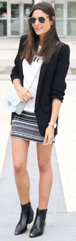 Federica L. + super cool + awesome monochrome style + plain white graphic tee + aztec print skirt + classic black blazer + shoulder padding + enhanced silhouette.   Jacket: Zara, Top/Skirt: Zara.