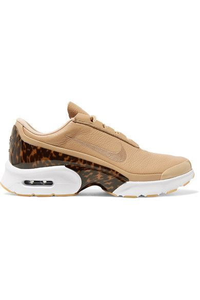 "Nike's 'Jewell LX' sneakers have 'Air Max' cushioned heels - the innovative technology is ""engineered for all-day, everyday comfort."" This pair is made from smooth beige leather and trimmed with a molded tortoiseshell heel counter. Wear yours with frayed jeans."