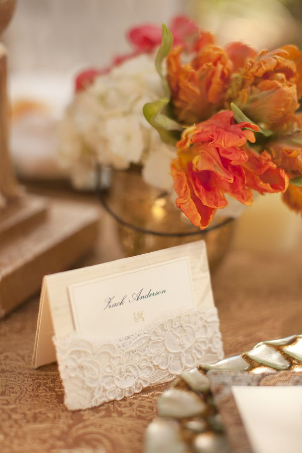 Vintage inspired champagne place card with lace and orange flowers - designed by Zenadia Designs, photo by Allyson Magda via JunebugWeddings.com