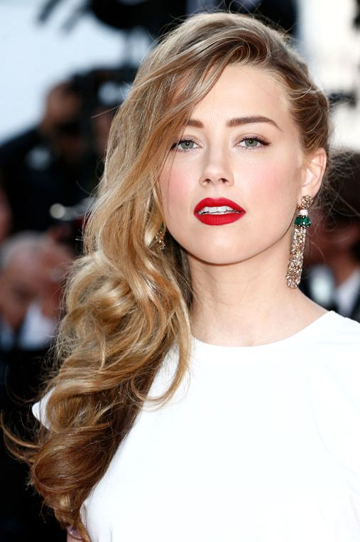 Amber Heard in one-side #braid with free natural curls on the other-side #hairstyle during #Cannes2014