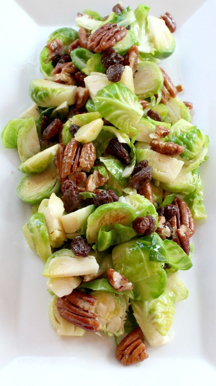 Brussel Sprout Salad With Dijon Mustard Dressing by bravoforpaleo #Salad #Brussel_Sprouts #Raisins #Pecans