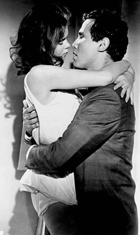 JOHNNY COOL (1963) - Mafia hitman Johnny Colini (Henry Silva) embraces his lover Dare Guiness, a wealthy divorcée Based on the novel, 'The Kingdom of Johnny Cool' by John McPartland - Directed by William Asher - United Artists - Publicity Still.