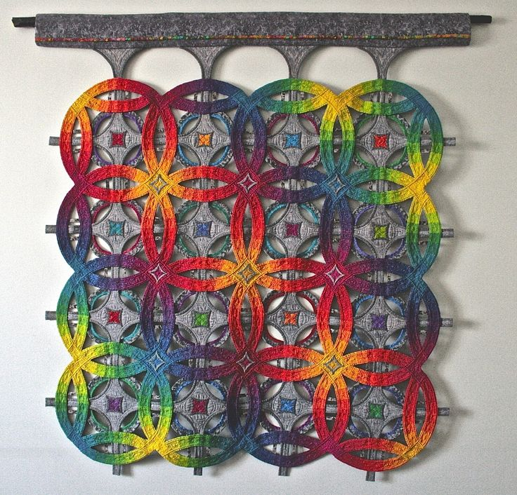 The Quilt Show Quilt of the Day. What a fascinating design! The grey and brights go well together