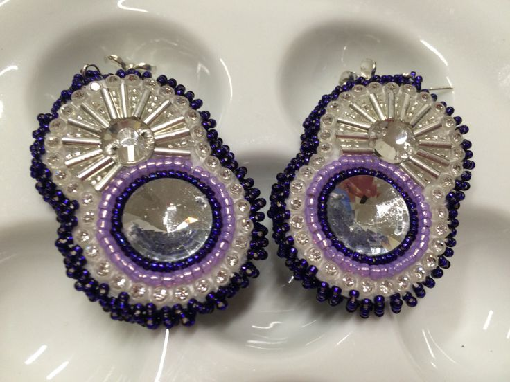 Purple starburst beaded earrings.
