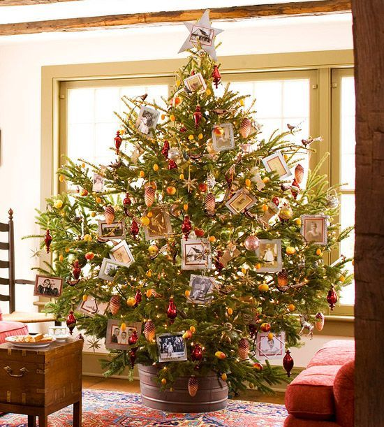 Photocopy pictures, glue them to silver paper, and frame them with rickrack and other trims to turn your Christmas tree into a family scrapbook. Fill the boughs with small apples, kumquats, and vintage-style ornaments. Editor's Lighting Tip: Pick lights in a color that match your key ornaments (in this case, orange). That way they enhance the color scheme rather than draw away from it.