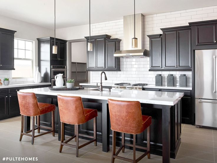 a classic kitchen high contrast finishes paired with worn leather accents adds just the - House Designs Kitchen