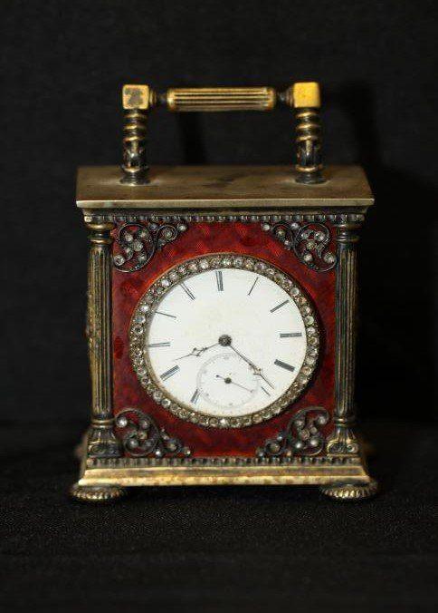 "Erik Kollin (1836-1901) Faberge carriage clock with diamond encrusted border around clock face, diamond encrusted eagle mounts on enamel side panels, marked on bottom of clock with the Faberge mark ""84"" ""EK"" in original Faberge box."