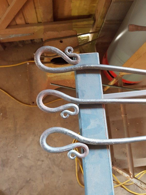 Freshly forged finials out of the furnace.