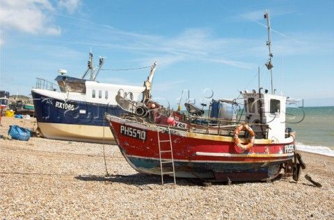 Fishing boats on shingle beach in Hastings Old Town England UK